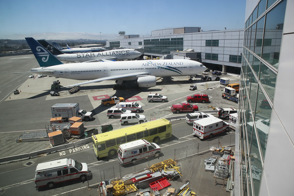 . Emergency vehicles are parked alongside jets at San Francisco International Airport on Saturday July 6, 2013,  after the crash of an Asiana Airlines jet. (Karl Mondon/Bay Area News Group)