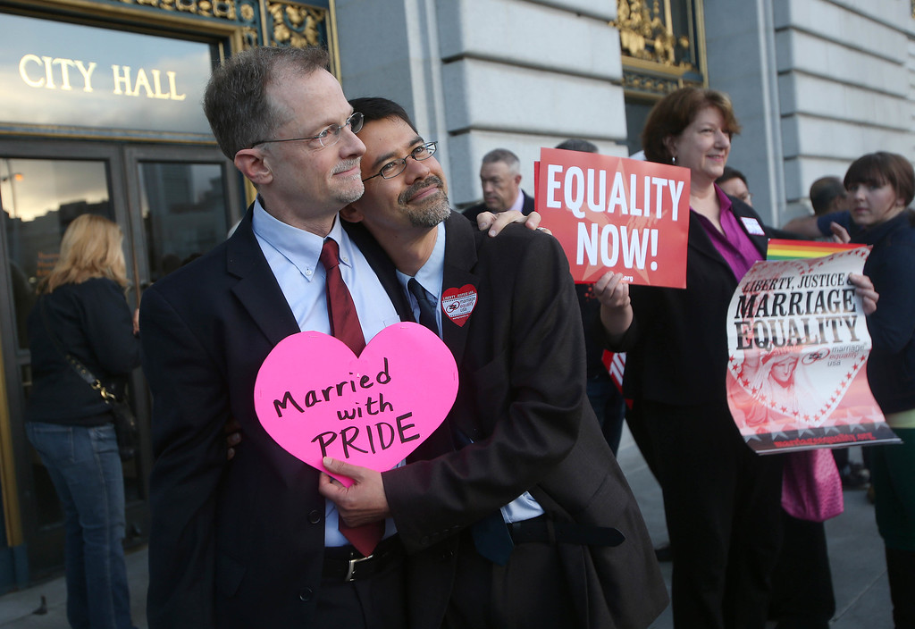 . Partners John Lewis, left, Stuart Gaffney, of San Francisco, await the the Supreme Court\'s decision on Proposition 8 and the Defense of Marriage Act during a screening at City Hall in San Francisco, Calif., on Wednesday, June 26, 2013. The U.S. Supreme Court dismissed California\'s Proposition 8 and declared the 1996 Defense of Marriage Act unconstitutional. (Jane Tyska/Bay Area News Group)