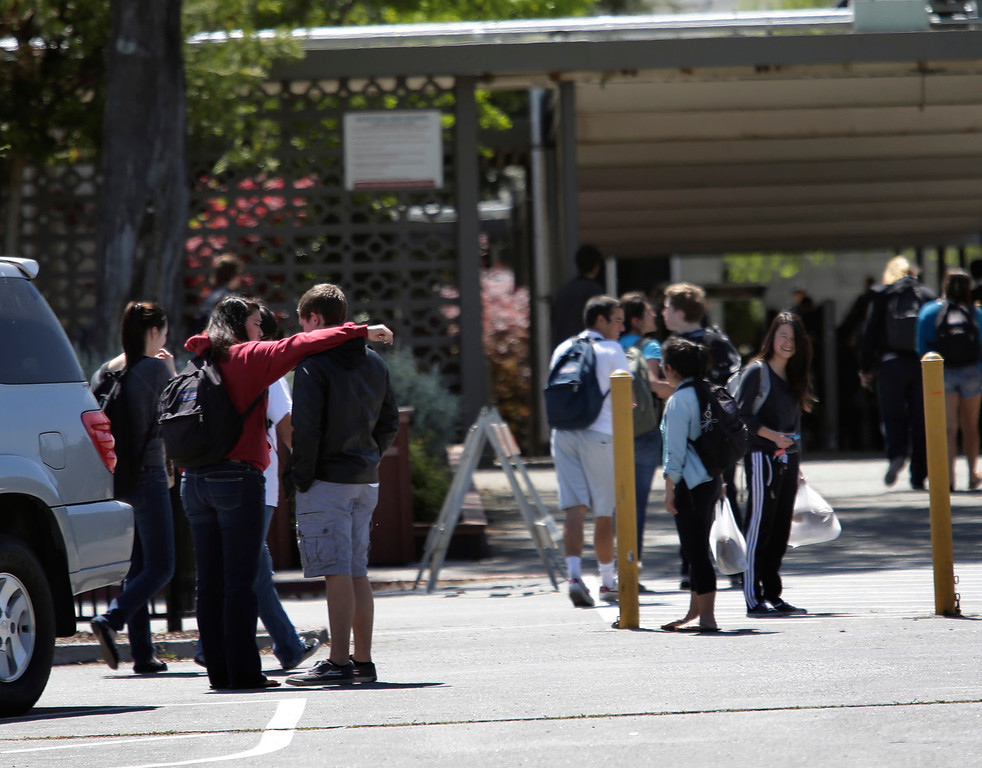 . Students return to Saratoga High School following the lunch hour in Saratoga, Calif., on Friday, April 12, 2013. Three 16-year-old boys were arrested yesterday in the sexual battery of an intoxicated and unconscious 15-year-old Saratoga High School student, who killed herself last fall after photos of the assault went viral. All three boys were students at the campus at the time of the assault last year. (Gary Reyes/Bay Area News Group)