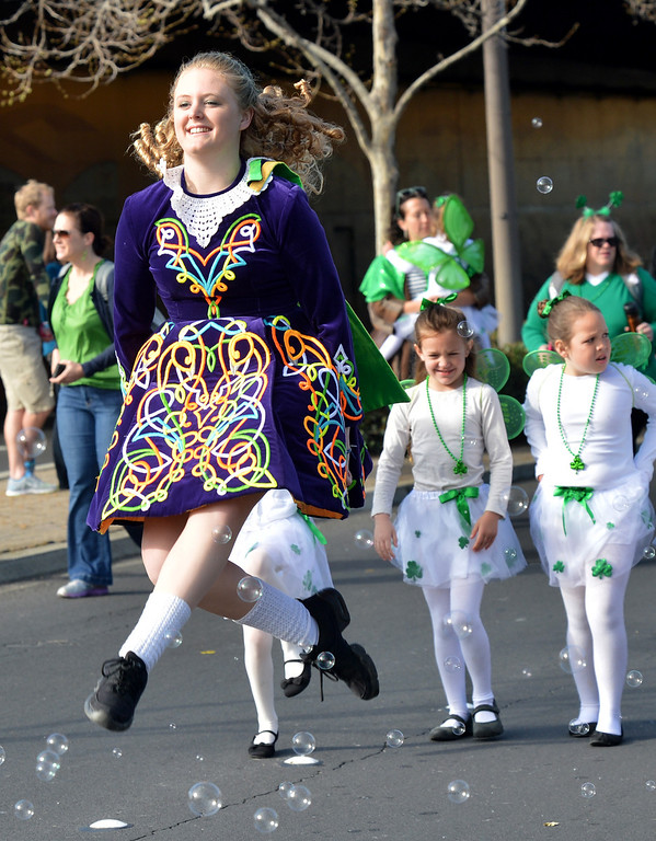 . Alexandra Brain, of Castro Valley, a dancer from Powell\'s Irish Dancers, jumps in the air while doing an Irish dance during the Saint Patrick\'s Day Parade in Dublin, Calif., on Saturday, March 16, 2013. (Dan Rosenstrauch/Staff)