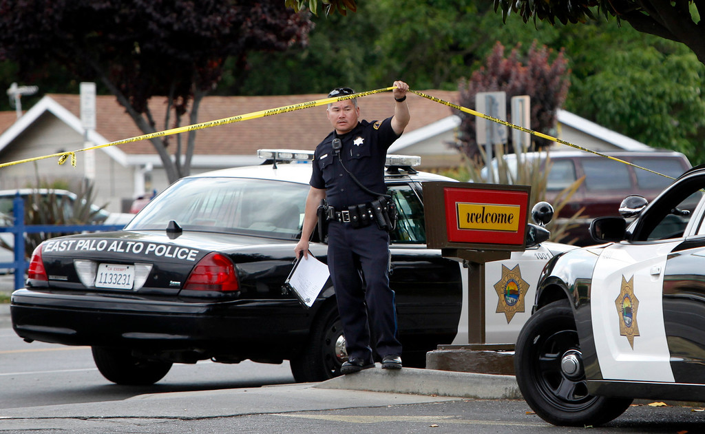 . Police investigate a crime scene where six people, including a 6-year-old child, were shot in broad daylight Sunday afternoon, May 5, 2013, at a busy McDonald\'s restaurant on University Avenue  in East Palo Alto, Calif. (Karl Mondon/Bay Area News Group)