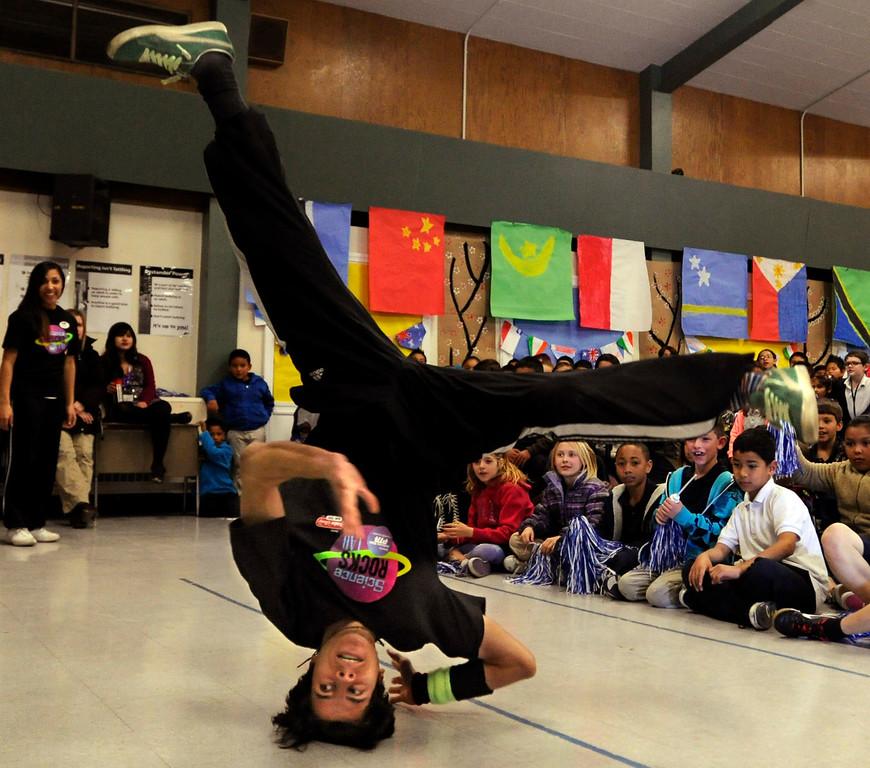 ". David Martinez, of San Francisco, performs a break dancing move at El Monte Elementary School as part of a \""Science Rocks\"" program in Concord, Calif., on Tuesday, Feb. 26, 2013. (Susan Tripp Pollard/Staff)"