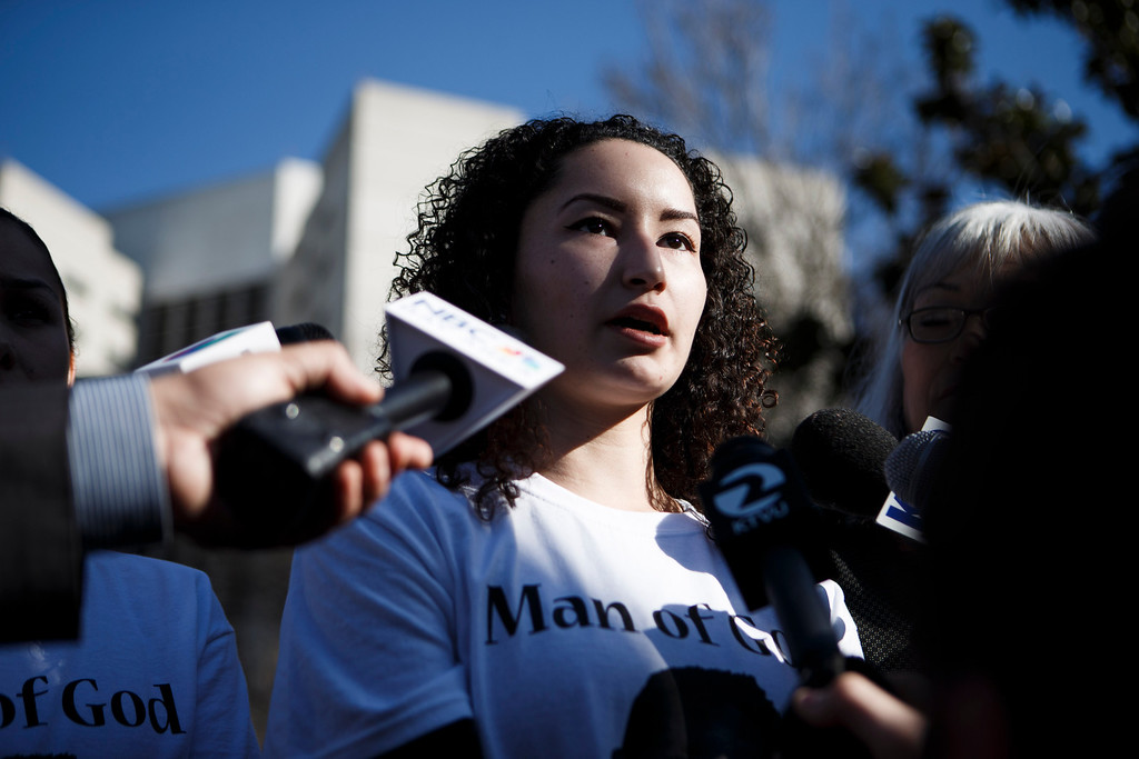 . Paulina Martinez, a relative of Luis Ricardo Hernandez, the apartment complex maintenance worker who allegedly shot to death a man he suspected of committing a series of burglaries at the apartment complex, speaks to the media in front of the Santa Clara County Hall of Justice prior to Hernandez\'s court appearance on Jan. 18, 2013 in San Jose. (Dai Sugano/Staff)