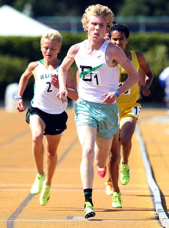 . Sir Francis Drake\'s John Lawson leads on the last lap of the boys 3200 meter final at the North Coast Section Meet of Champions at Cal\'s Edwards Stadium in Berkeley, Calif., on Saturday, May 25, 2013. Hutchins placed second in the race. Lawson placed first. (Anda Chu/Bay Area News Group)
