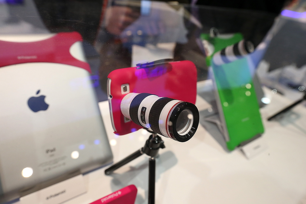 . A Polaroid lens adapter for an iPhone is displayed during the 2013 International CES at the Las Vegas Convention Center on January 8, 2013 in Las Vegas, Nevada. (Photo by Justin Sullivan/Getty Images)