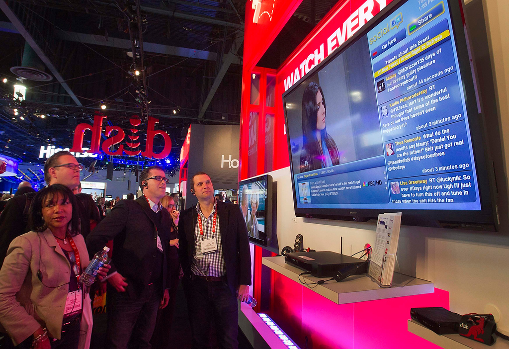 . Twitter feeds are displayed to the right of a TV soap opera broadcast, during a demonstration of a Dish Network social media application, during the first day of the Consumer Electronics Show (CES) in Las Vegas January 8, 2013. (REUTERS/Steve Marcus)