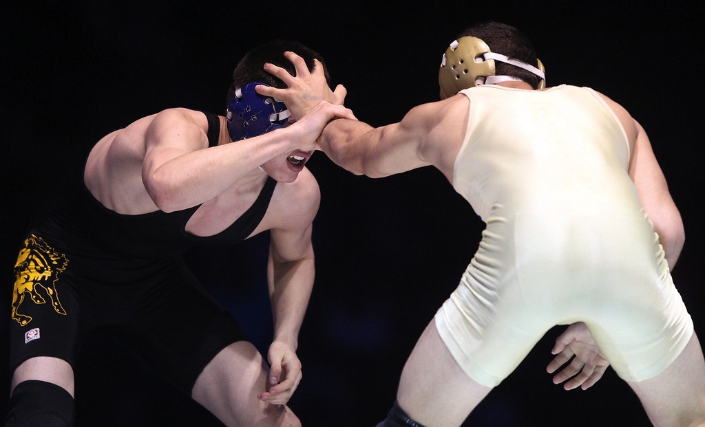 . Gilroy\'s Paul Fox, left, wrestles against St. John Bosco\'s Aaron Pico in the 132-pound championship match during the California Interscholastic Federation wrestling championships in Bakersfield, Calif., on Saturday, March 2, 2013. Pico would go onto win 12-3. (Anda Chu/Staff)