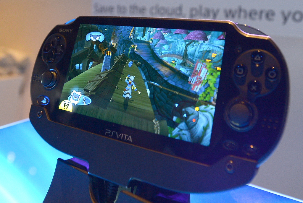 . Visitors check Sony\'s new portable gaming console PSVITA during the 2013 International CES at the Las Vegas Convention Center on January 8, 2013 in Las Vegas, Nevada. (JOE KLAMAR/AFP/Getty Images)