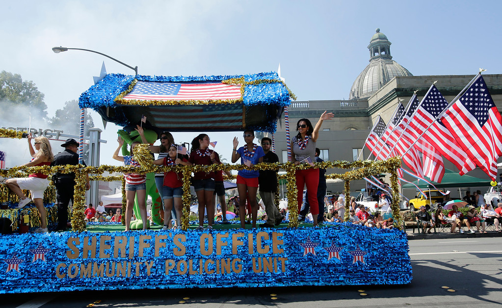 . A float from the San Mateo County Sheriff\'s Office passes old city hall during the annual Fourth of July parade in Redwood City, Calif. on Thursday, July 4, 2013. Considered the largest Independence Day parade in Northern California, it is celebrating its 75th year. (Gary Reyes/Bay Area News Group)