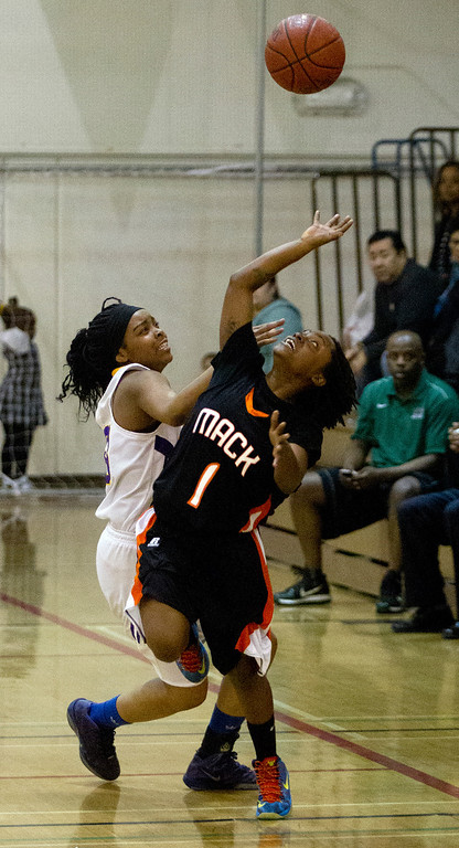 . Oakland Technical High School\'s London Robinson, left, and McClymonds High School\'s Gabby Gaines vie for a loose ball during the fourth quarter of their Oakland Athletic League girls\' basketball game, Wednesday, Feb. 20, 2013 in Oakland, Calif. McClymonds won, 62-50. (D. Ross Cameron/Staff)