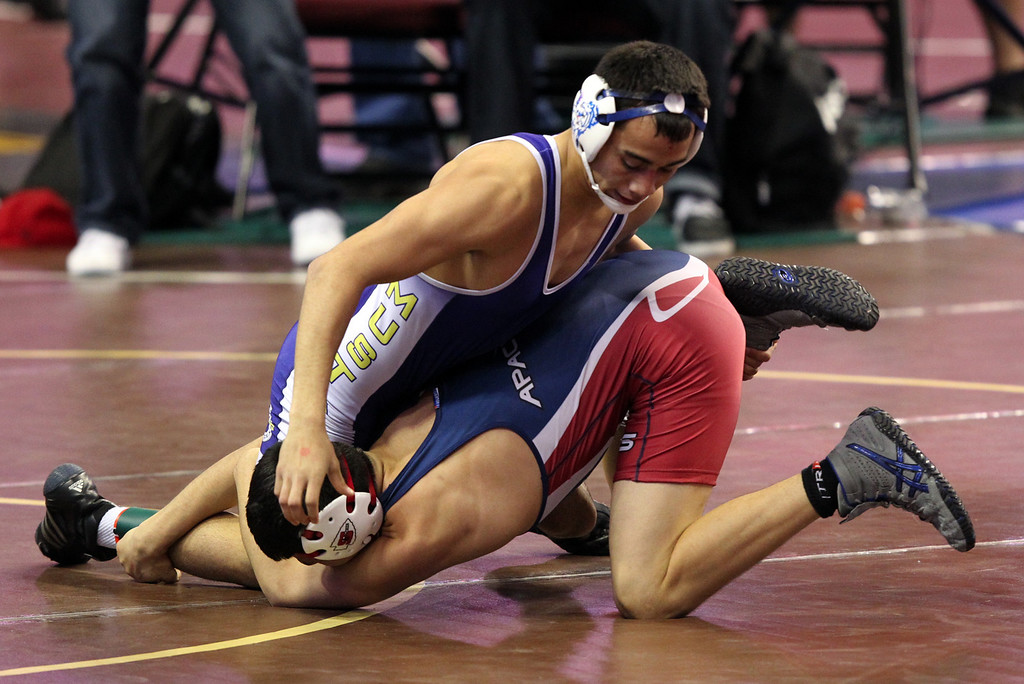 . Gilroy\'s Nikko Villarreal, right, wrestles Sanger\'s Rosario Sanchez in a 138-pound first round match during the California Interscholastic Federation wrestling championships in Bakersfield, Calif., on Friday, March 1, 2013. Villarreal would go on to win. (Anda Chu)