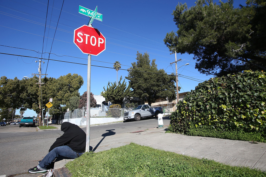 """. Alberto, 19, grieves for his friend Ken Harbin at a homicide scene on 94th Avenue and Hillside Street in Oakland, Calif. on Saturday, Jan. 12, 2013.  Harbin, 17, who lived nearby, was shot and killed there on Friday night about 8:15 p.m. according to Oakland police. There were four homicides in six hours on Friday in Oakland. \""""Revenge, revenge, the killing never ends,\"""" Alfredo said. He did not wish to give his last name. (Jane Tyska/Staff)"""