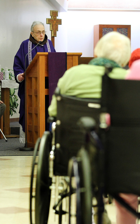 . Father Larry Dunphy, O.F.M. gives Mass on Ash Wednesday to seniors at the Mercy Retirement & Care Center in Oakland, Calif. on Wednesday, Feb. 13, 2013.  Father Larry, a Franciscan Priest,  comes to the Senior Care Center to deliver Mass for the many seniors who are unable to travel outside of the center.  Mass is delivered every Sunday at the center where the average age is 91 years old and 90% of the residents are catholic.  During Lent, they will have Stations of the Cross prayer service every Friday at 2:00 pm. (Laura A. Oda/Staff)