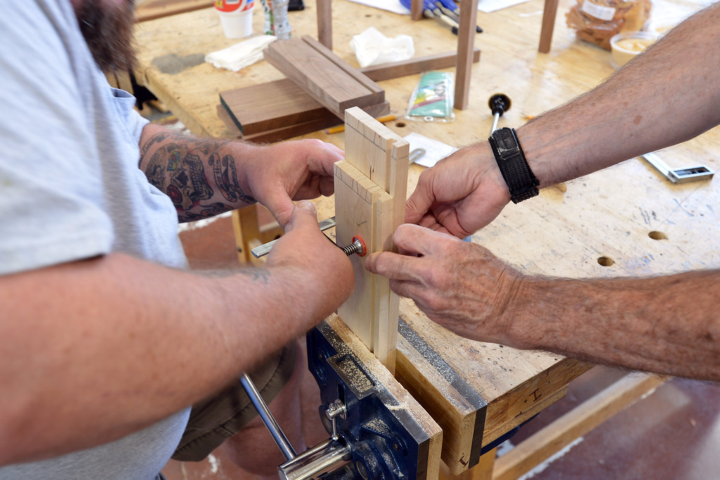 . Jason Deitch, left, gets help from Harold Mantle as he cuts dovetail joints for a woodworking project in Pleasant Hill, Calif. on Wednesday, July 24, 2013. The Diablo Woodworkers are reaching out to military veterans like Deitch and emphasizing the therapeutic qualities of woodworking. (Kristopher Skinner/Bay Area News Group)