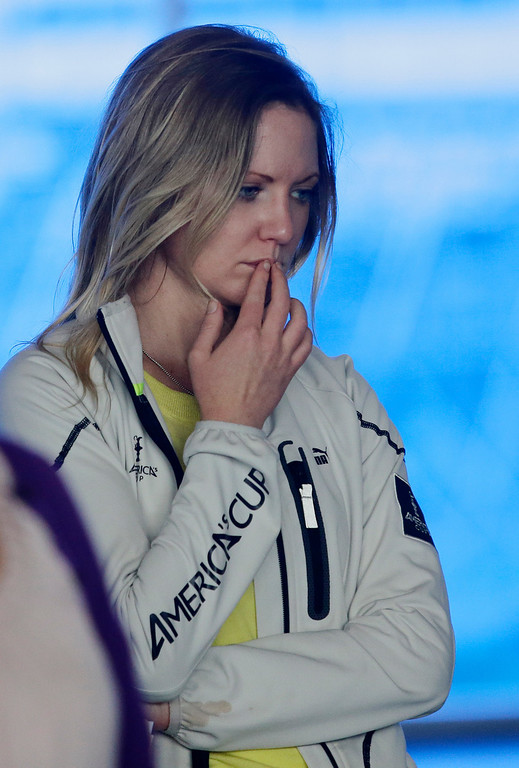 ". Catherine Enright, staff member of America\'s Cup, listens during a press conference on yesterday\'s training tragedy in San Francisco, Calif. on Friday, May 10, 2013. Two-time Olympic medalist, Andrew ""Bart\"" Simpson was killed yesterday afternoon when the Artemis Racing team\'s 72-foot catamaran capsized during a practice run for America\'s Cup in the San Francisco Bay. Simpson was trapped beneath the boat and died after efforts to revive him failed.  (Gary Reyes/ Bay Area News Group)"