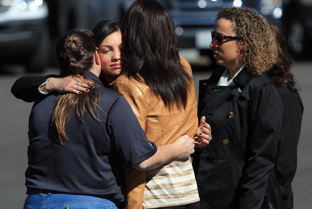 . Mourners console each other during funeral services for Santa Clara paramedic Quinn Boyer, 34, of Dublin, at St. Theresa Catholic Church in Oakland, Calif., on Tuesday, April 16, 2013.  (Jane Tyska/Staff)