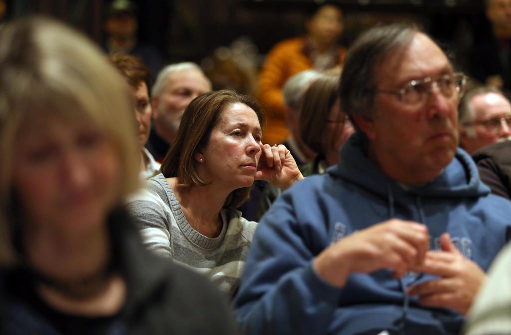 . Barbara Dukas, of Piedmont, center, listens to Piedmont Police Chief Rikki Goede speak during a town hall meeting at the Piedmont Veterans Hall in Piedmont, Calif., on Tuesday, Feb. 12, 2013. (Jane Tyska/Staff)