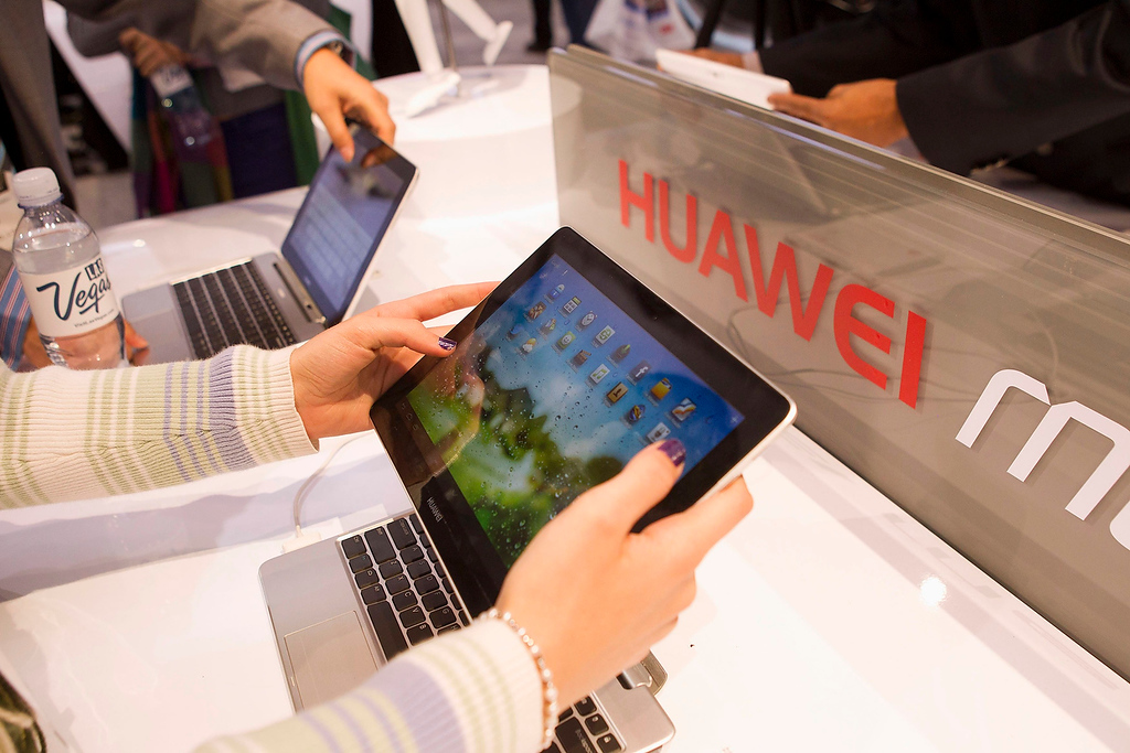 . A woman looks over the Huawei MediaPad, a 10-inch Android-based notebook with detachable tablet, at the Huawei booth during the first day of the Consumer Electronics Show (CES) in Las Vegas January 8, 2013. (REUTERS/Steve Marcus)