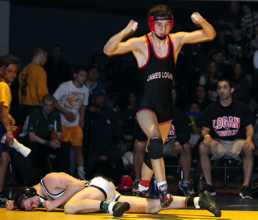 . James Logan\'s Artemio Flores, right, celebrates his win over Windsor\'s Logan Fore in the 126-pound finals at the North Coast Section wrestling championships held at Newark Memorial High School in Newark, Calif., on Saturday, Feb. 23, 2013. (Anda Chu/Staff)