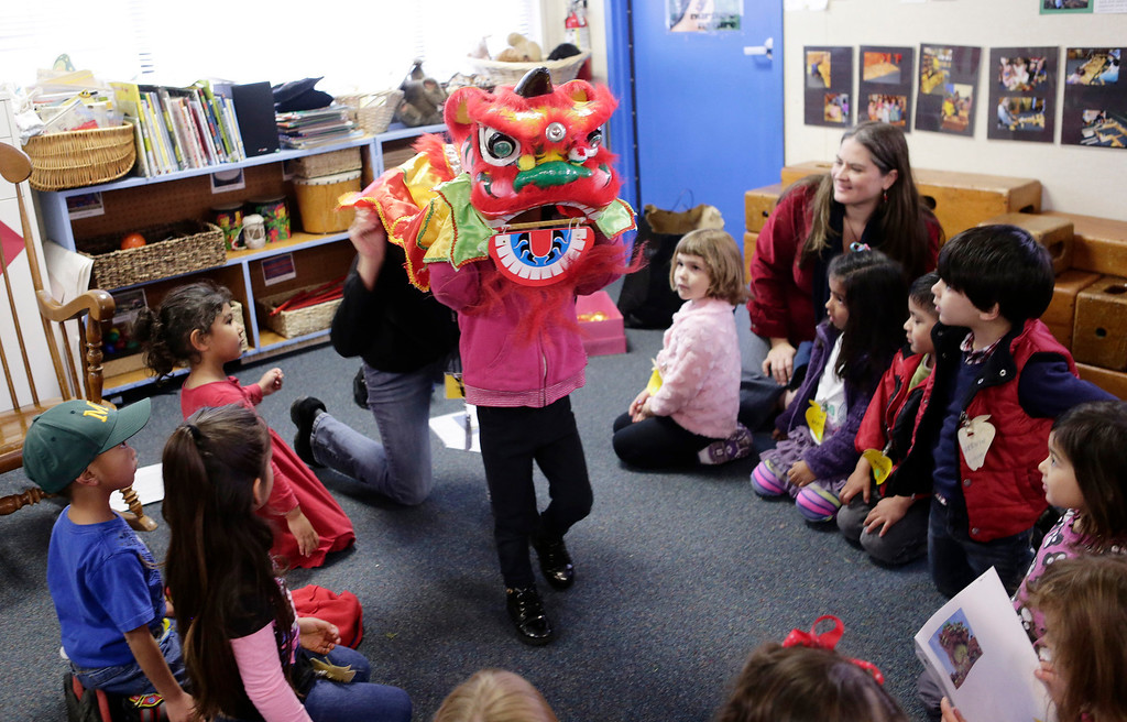 . Preschoolers celebrate the Lunar New Year at the Mountain View Parent Nursery School in Mountain View, Calif. on Friday, Feb. 8, 2013. The Mountain View-Whisman School District has decided that if parents hold back an eligible child from kindergarten, it will help evaluate those children for kindergarten-readiness the following year. Some will be sent to first grade rather than kindergarten. (Gary Reyes/ Staff)