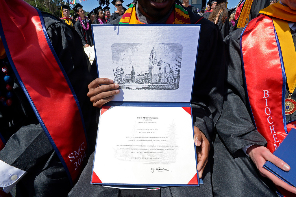 . Nathaniel Williams, of Lathrop, shows off his certificate of participation inside his diploma holder during the 2014 Saint Mary\'s College commencement ceremony in Moraga, Calif., on Saturday, May 24, 2014. A total of 758 students graduated making this the largest graduating class in school history. (Jose Carlos Fajardo/Bay Area News Group)