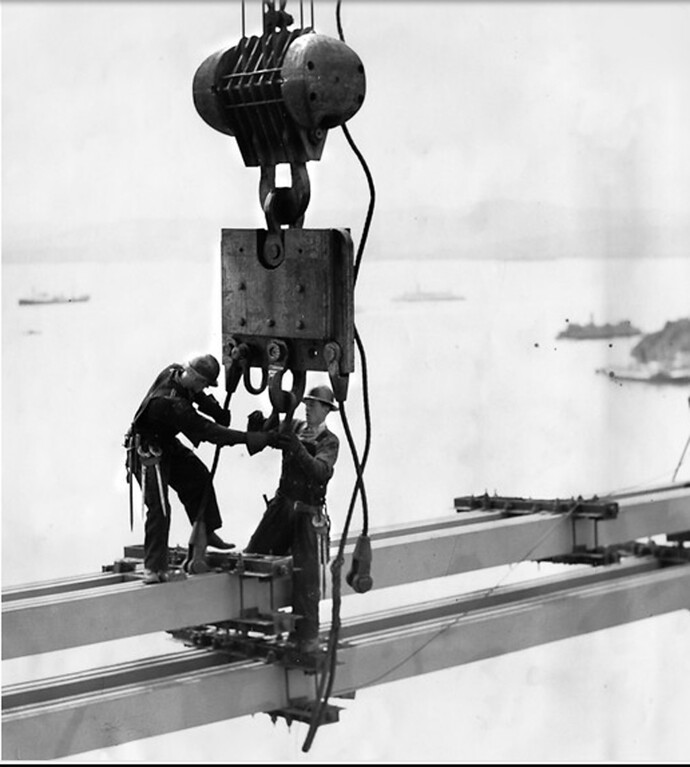 . March 1936 - Workers connect the first link in the 1400-foot cantilever spam for the Eastbay portion of the bridge. (Oakland Tribune Photo)
