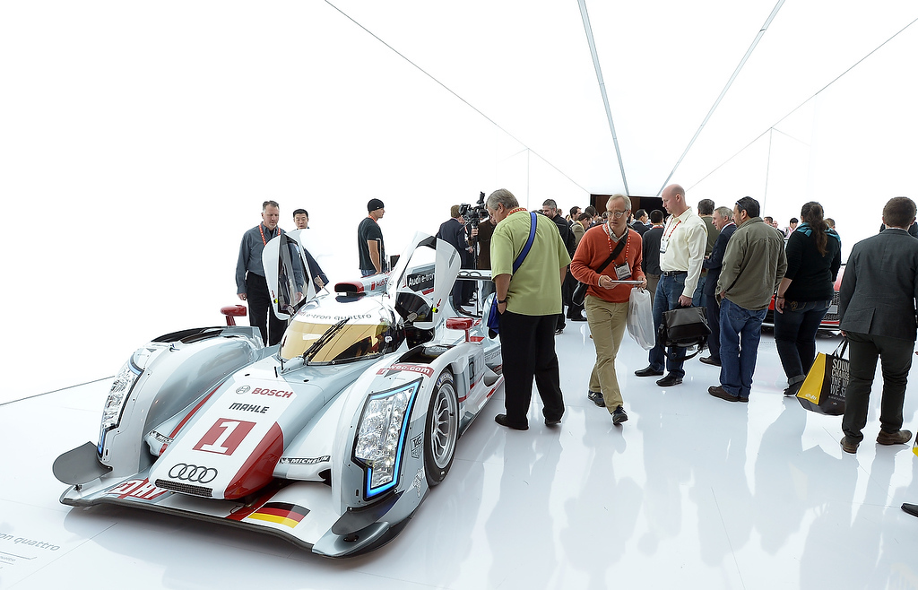 . Consumers view the Audi R18 e-tron quattro hybrid racing car and first hybrid to win the LeMans race in 2012, at the 2013 International CES at the Las Vegas Convention Center on January 8, 2013 in Las Vegas, Nevada. (JOE KLAMAR/AFP/Getty Images)
