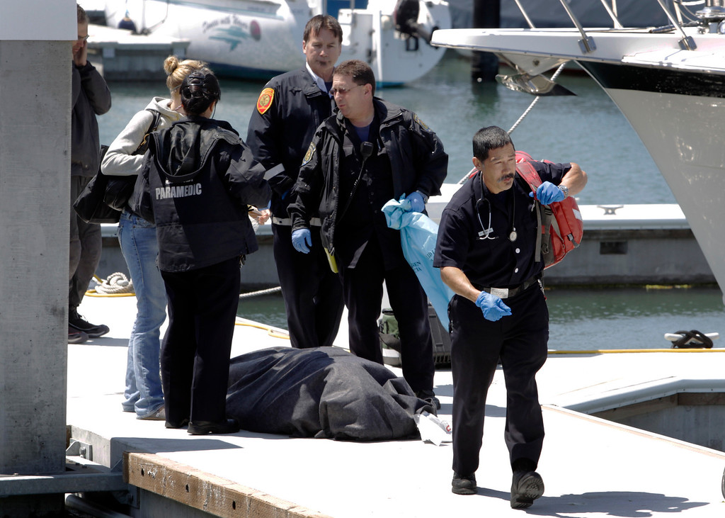 . A paramedic leaves a dock in the Marina District after attempts to save sailor Andrew Simpson, of Great Britain, were unsuccessful, Thursday, May 9, 2013, in San Francisco, Calif. Simpson died after the Artemis Racing AC72 catamaran, an America\'s Cup entry from Sweden, capsized during training in San Francisco Bay, the team said.  (AP Photo/San Francisco Chronicle, Paul Chinn)