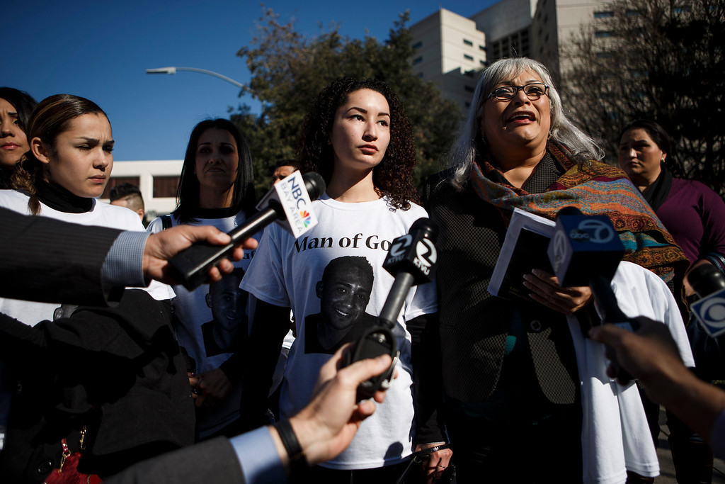 . Gina Gates, right, a relative of Luis Ricardo Hernandez, the apartment complex maintenance worker who allegedly shot to death a man he suspected of committing a series of burglaries at the apartment complex, speaks to the media in front of the Santa Clara County Hall of Justice prior to Hernandez\'s court appearance on Jan. 18, 2013 in San Jose.  Standing next to Gates is Paulina Martinez, center, Hernandez\'s relative. (Dai Sugano/Staff)