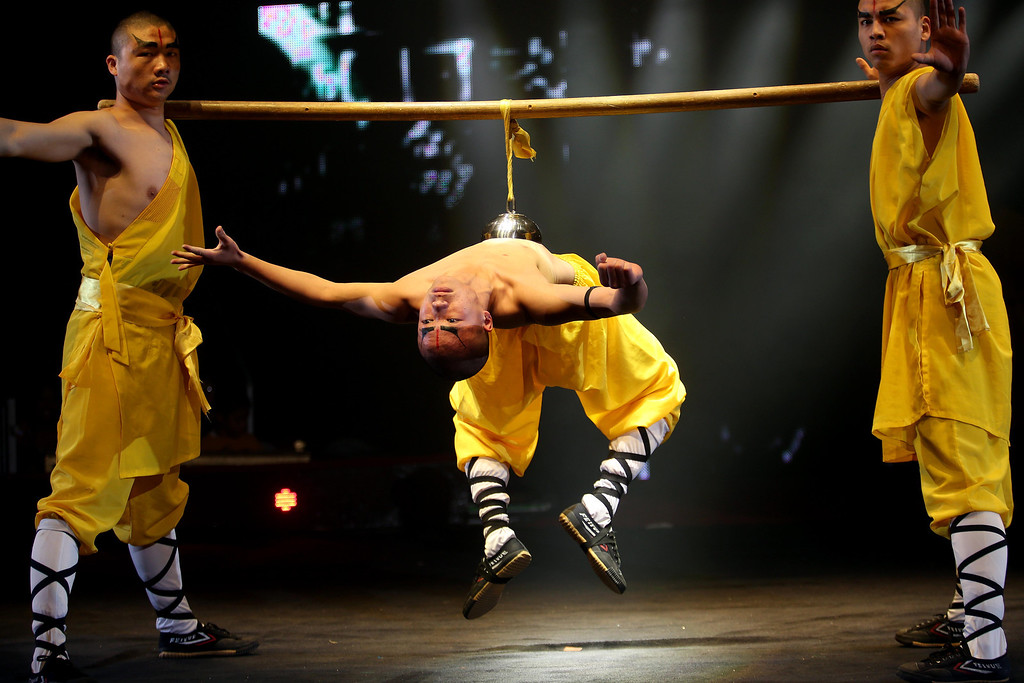 . The Shaolin Warriors perform during the UniverSoul Circus show under the big top on Hegenberger Road in Oakland, Calif., on Friday, April 5, 2013.  (Jane Tyska/Staff)