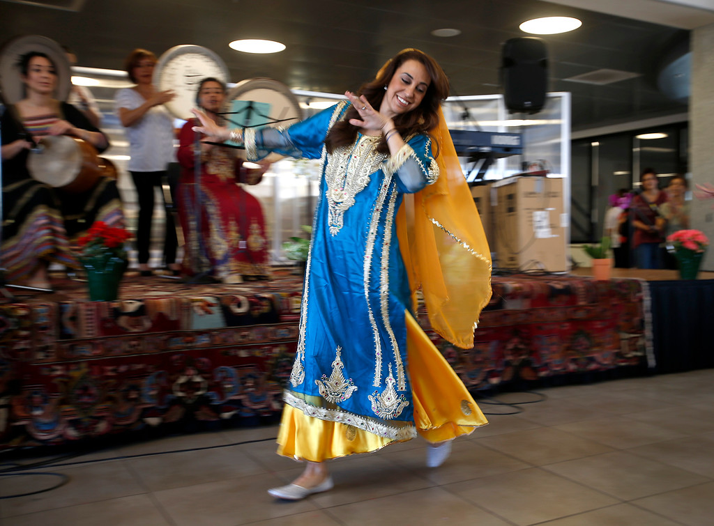 . Master of ceremonies Renee Paquier dances during the West Valley College 6th Annual Persian New Year Celebration at the college in Saratoga, Calif. on Monday, March 10, 2014.  (Nhat V. Meyer/Bay Area News Group)