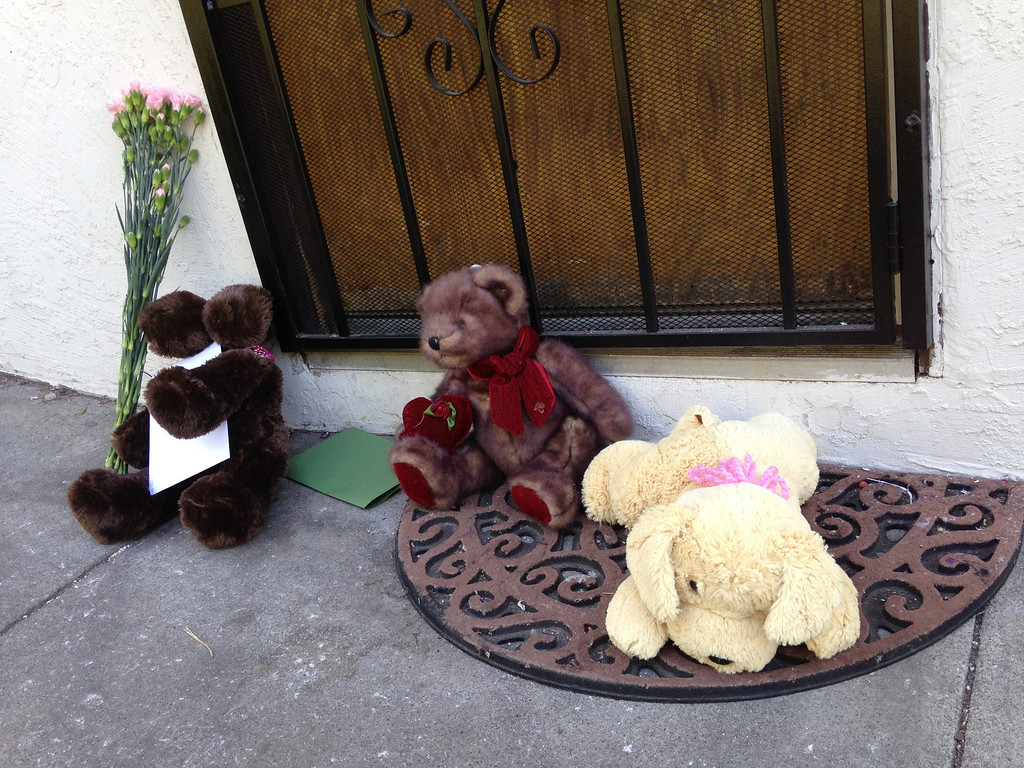 . Stuffed animals, flowers and cards were left at the apartment complex where an 8-year-old girl was killed the night before in Oakland, Calif., on July 18, 2013. (Anda Chu/Bay Area News Group)