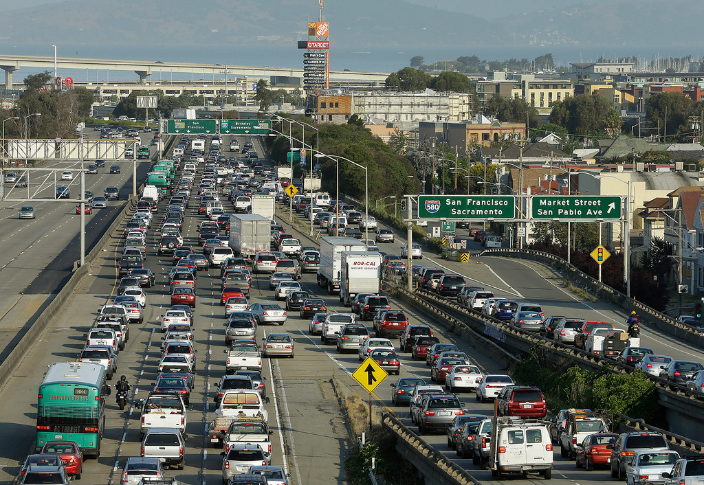 . Commuters wait in traffic on Interstate 80 and 580 on approach to the San Francisco-Oakland Bay Bridge Monday, July 1, 2013, in Oakland, Calif. (AP Photo/Ben Margot)