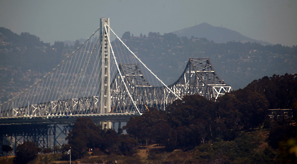 . Almost a quarter century after the Loma Prieta earthquake revealed the deadly vulnerability of the old eastern span of the Bay Bridge, a replacement is under construction Friday, May 24, 2013 in the middle of San Francisco Bay. (Karl Mondon/Bay Area News Group)