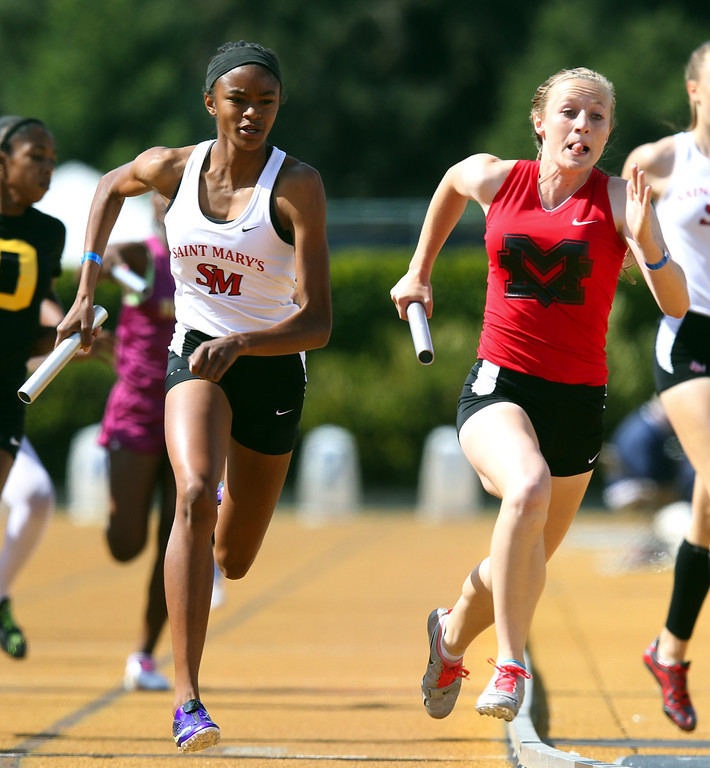 . St. Mary\'s Nia Joyner, left, competes against Monte Vista\'s Mattingly Gebhart in the girls 4x400  meter relay final at the North Coast Section Meet of Champions at Cal\'s Edwards Stadium in Berkeley, Calif., on Saturday, May 25, 2013. St. Mary\'s placed first and Monte Vista placed second. (Anda Chu/Bay Area News Group)