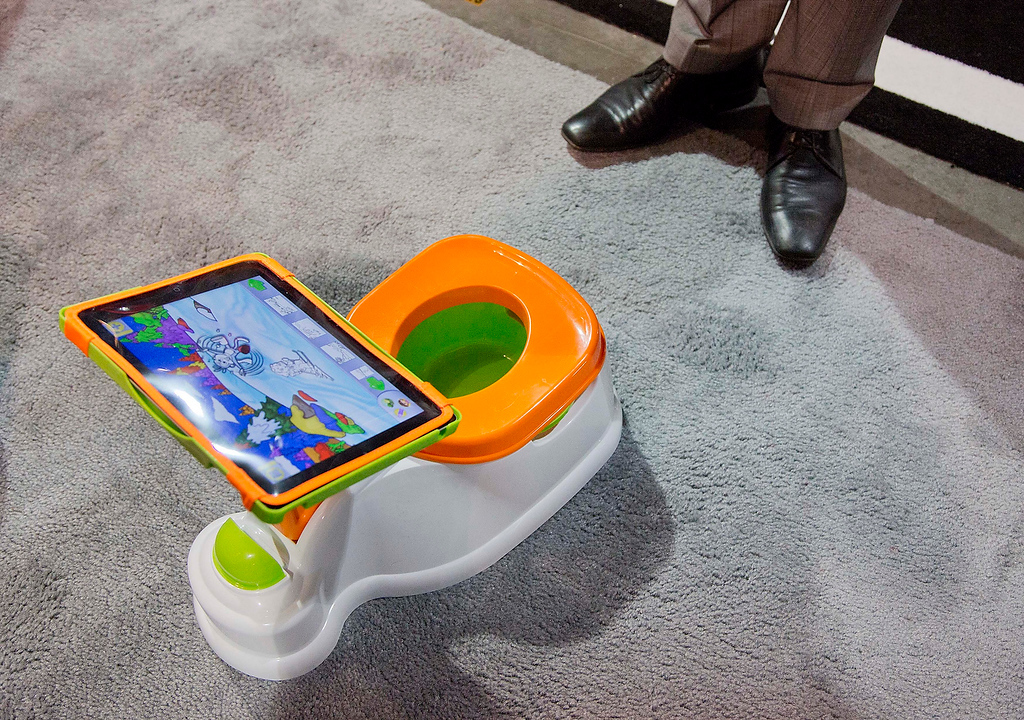 . The iPotty for iPad potty training device is see on display at the Consumer Electronics Show, Wednesday, Jan. 9, 2013, in Las Vegas. No app is available to go with the trainer, but the idea is to keep the child on the toilet for as long as necessary by keeping them digitally entertained. (AP Photo/Julie Jacobson)