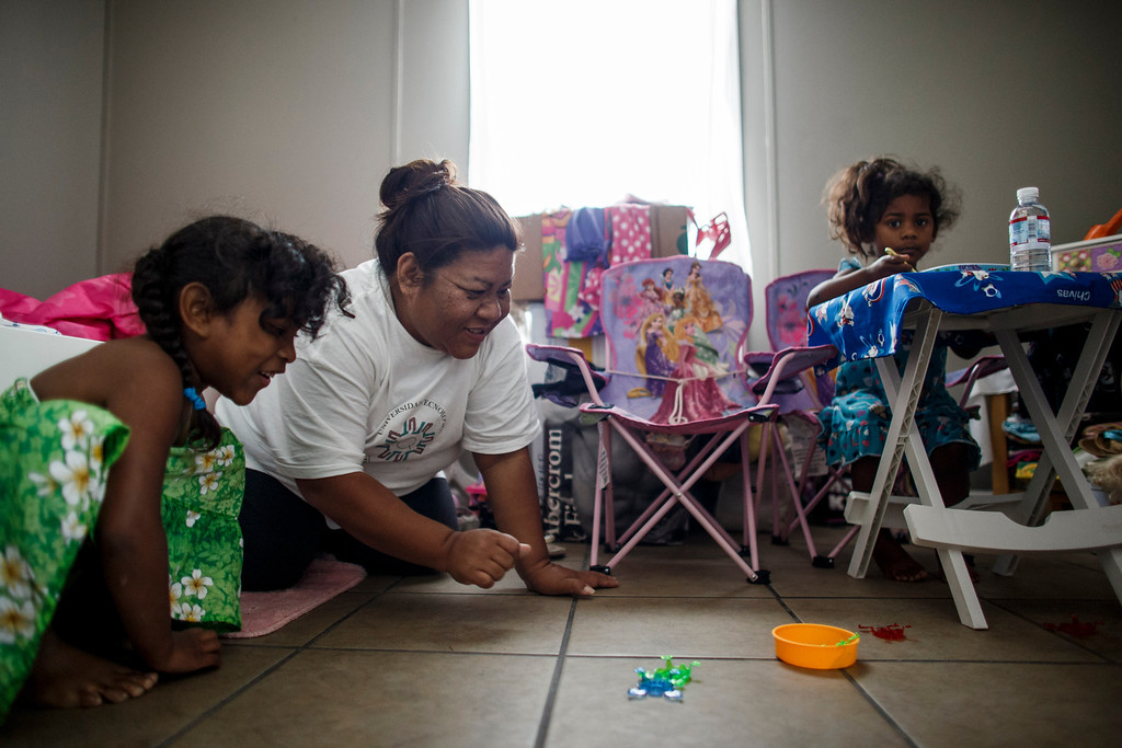 . Clarissa Taitano plays with her daughters, A\'Riyah Jackson, 5, left, and I\'Yannah Jackson, 3, in their mobile home on May 24, 2013, in San Jose. The family recently moved to their mobile home after living in a Santa Clara motel for 64 days. (Dai Sugano/Bay Area News Group)