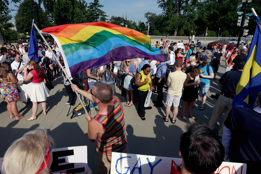 . Gay rights supporter Vin Testa waves a rainbow flag outside the U.S. Supreme Court building on June 26, 2013, in Washington, D.C. The high court is expected to rule on the DOMA and Prop 8 gay marriage cases.  (Win McNamee/Getty Images)