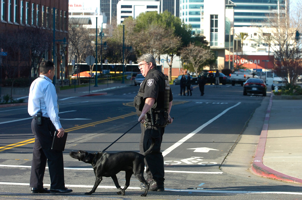 . Police officers with dogs respond to a building at 5885 Hollis St. that received a bomb threat in Emeryville, Calif. on Wednesday, Feb. 6, 2013. Two floors of the  building house facilities for Lawrence Berkeley National Laboratory. (Kristopher Skinner/Staff)