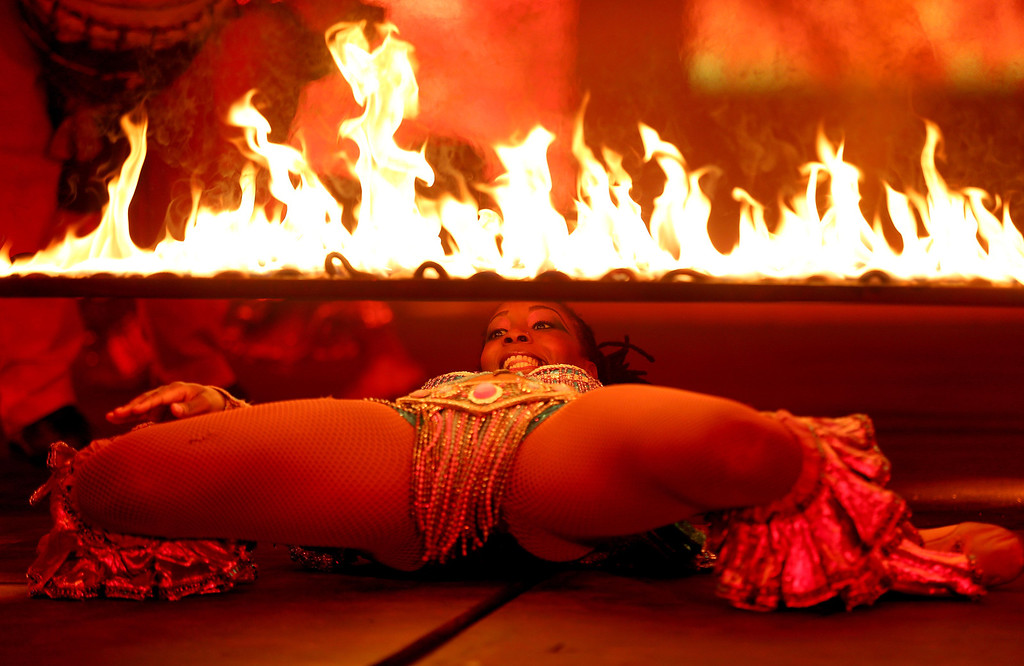 . A dancer does a fire limbo during the Caribbean segment as the UniverSoul Circus performs under the big top on Hegenberger Road in Oakland, Calif., on Friday, April 5, 2013.  (Jane Tyska/Staff)