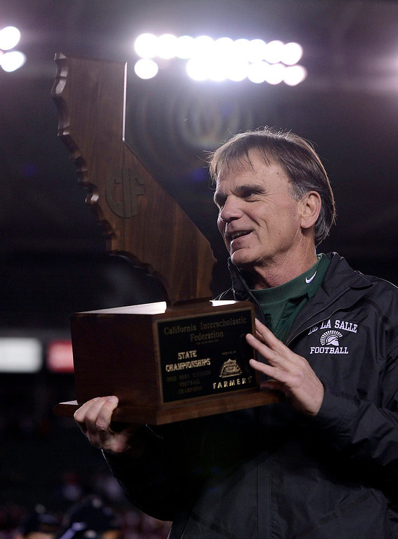 . De La Salle Spartans head coach Bob Ladouceur holds the state championship trophy after defeating the Centennial Huskies in the Open Division during the 2012 CIF State Football Championship at Home Depot Center in Carson , Calif. on Saturday, Dec. 15, 2012. De La Salle defeated Centennial 48-28. (Jose Carlos Fajardo/Staff)