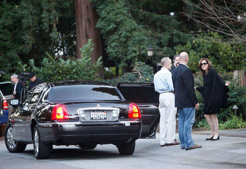 """. A guest arrives to a campaign fundraiser for New Jersey Republican Gov. Chris Christie walks past protesters standing in front of the home of Facebook CEO Mark Zukerberg in Palo Alto on Wednesday, Feb. 13, 2013. About 40 protesters rallied in front of the home, saying they objected to Christie�s visit because of his efforts to strip funding from Planned Parenthood and other women�s reproductive health care programs. Protester and Palo Alto resident Cheryl Lilienstein said she wondered whether Zuckerberg had any idea what Planned Parenthood means for women\'s health or what Christie�s stances are. \""""I hope he\'s just confused,\"""" she said. Zuckerberg and wife Priscilla Chan first got to know Christie after donating $100 million to struggling Newark, N.J., schools two years ago, according to a Facebook spokeswoman.   (Kirstina Sangsahachart/ Daily News)"""