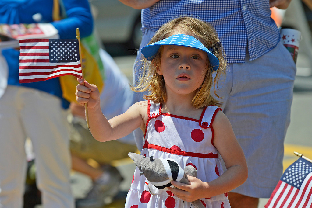 . Sadie Siedel, 2, of Oakland, waves a U.S. flag while watching Piedmont\'s July 4th parade in Piedmont, Calif., on Thursday, July 4, 2013. (Jose Carlos Fajardo/Bay Area News Group)