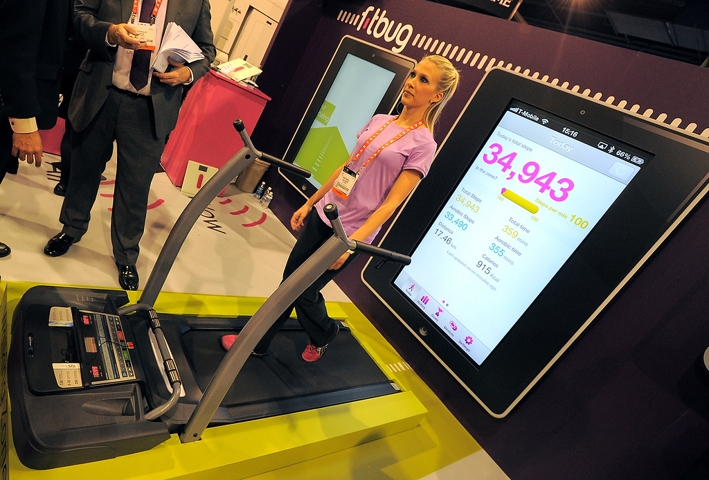 . Woman uses The Fitbug pedometer ,system uplinks to a web site to track your walking steps, distance, diet and fitness activities, at the Las Vegas Convention Center on January 9, 2013 in Las Vegas, Nevada. (JOE KLAMAR/AFP/Getty Images)
