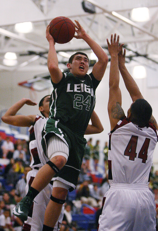 . Leigh\'s Kyle Morrison shoots over Piedmont Hills\' Joseph Alvarez in the first quarter during the Blossom Valley Athletic League boys basketball championship game at Independence High School in San Jose, Calif. on Friday, Feb. 15, 2013. (Jim Gensheimer/Staff)