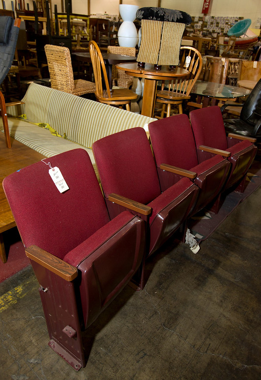 . A row of movie theater seats awaits a new owner, at the annual White Elephant Sale, at the Oakland Museum Women\'s Board 96,000-square-foot warehouse in Oakland, Calif., Tuesday, Jan. 15, 2013. (D. Ross Cameron/Staff)