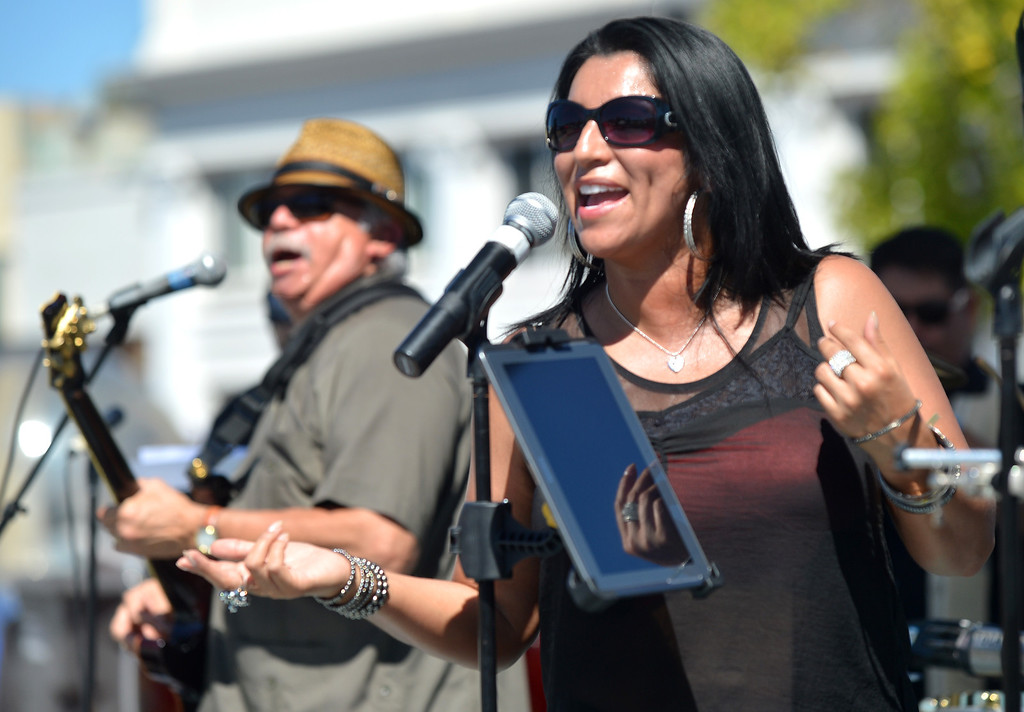 """. Blanca Rodriquez of \""""Mystique\"""" sings during the the 29th annual Pittsburg Seafood and Music Festival in the city\'s historic Old Town in Pittsburg, Calif., on Saturday, Sept. 7, 2013. (Dan Rosenstrauch/Bay Area News Group)"""