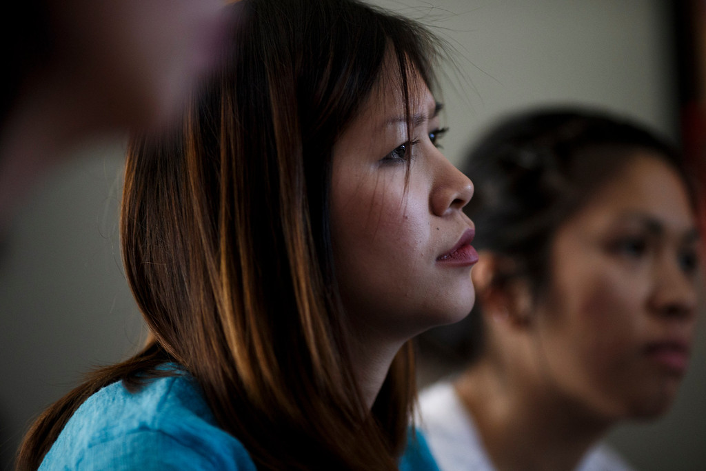 . Jennie-Diem Nguyen, center, and her sister, Dee Nguyen, right, recount the death of their brother, Vince Canh Xuan Nguyen, to this newspaper on July, 16, 2013 at their mother\'s San Jose home.  The San Jose family believes there may be foul play behind the death of Vince Canh Xuan Nguyen, shown in a photo at right, who passed away in a tiny hotel room in Vietnam on July 1, 2013, after a night of drinking ended with him gravely ill, unable to control his body functions. (Dai Sugano/Bay Area News Group)
