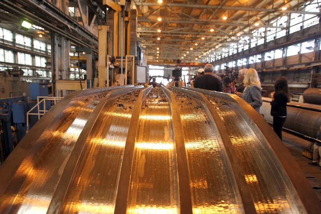 . An upper saddle piece for the new eastern span sits next to the precision machine as members of the media tour XKT Engineering in Vallejo, Calif., on Wednesday, July 31, 2013. The Vallejo company is fabricating the saddle and cable fix for the new span�s broken bolts. (Ray Chavez/Bay Area News Group)