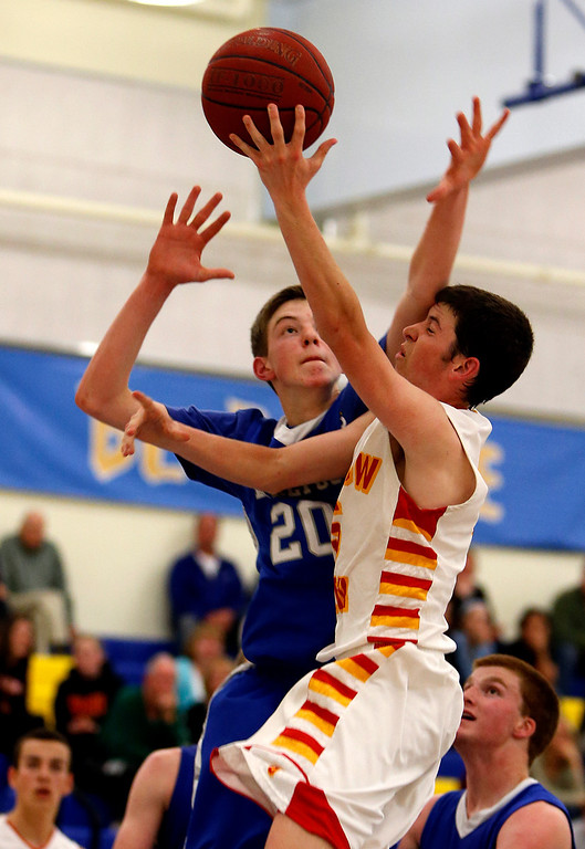 . Willow Glen High School\'s Mikey Riley (5) is fouled while taking a shot against Los Altos High School\'s Daniel Rosenbaum (20) in the fourth period for the CCS Division II Boys Basketball semifinals at Santa Clara High School in Santa Clara, Calif., on Tuesday, Feb. 26, 2013.  Willow Glen High School won 59-57.  (Nhat V. Meyer/Staff)